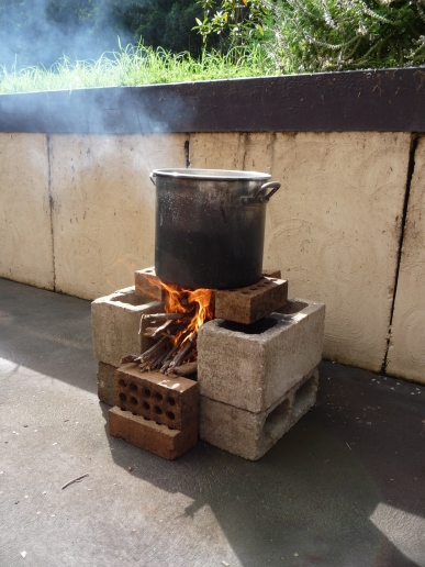 Boiling water on the makeshift rocket stove