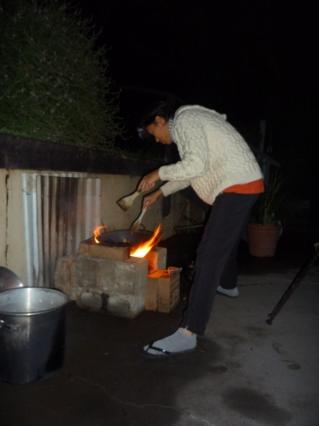 Cooking dinner - stir-fry in the wok on the rocket-stove!